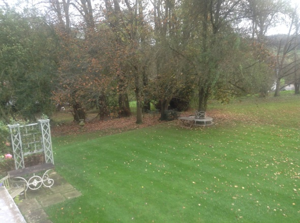 Photo 7(c) - looking out of a bedroom window over the front lawn, garden and Footpath ER183
